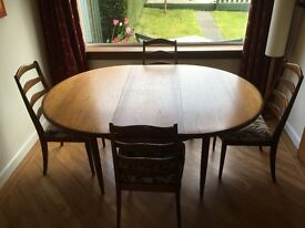 G Plan circular / extendable table with matching chairs