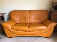 Orange leather two seater couch