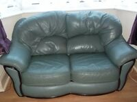 3 seater and 2 seater green leather sofas