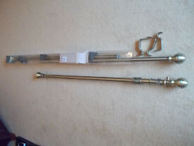 Matching Pair of Brass effect Curtain Poles.