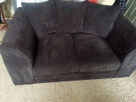 6 MONTH OLD DARK BROWN CORD 2 SEATER SOFA.
