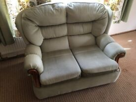 2 seater sofa nice condition.with wooden detail