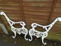 Bench ends with lions heads as handles, made of light metal.