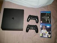 PS4 Slim 1tb with FIFA 18, Skyrim and extra pad