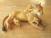 ELC / AAA lioness with 3 cubs