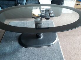 Black and clear glass coffee table.