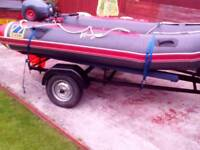 Zodiac inflatable boat,engine and trailer