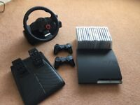 PlayStation 3 slim 320gb with games and steering wheel