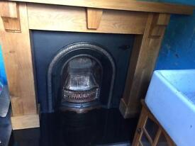 A cast iron open fireplace complete surround