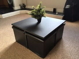 Stylish black table and footstool set