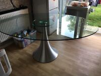 Oval glass dining table.