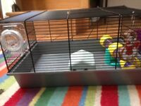 2 hamster cages with toys