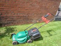 QUALCAST ELECTRIC LAWNMOWER WITH LONG LEAD AND GRASS COLLECTION BOX CAN BE SEEN WORKING