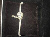 Pandora bracelet plus 4 charms