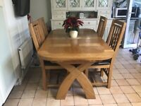 Solid Oak extendable table and four chairs