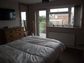 Large double en suite room with balcony over looking Weymouth Bay Preston