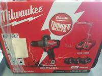 Milwaukee FUEL 18v percussion drill with 3x 5.0 ah batteries and charger