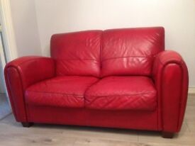 Red leather sofas and armchair