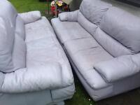 Two grey leather sofas free from Blackhall