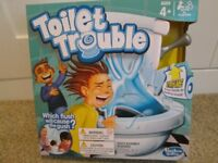 TOILET TROUBLE BOXED GAME. BRAND NEW. DUPLICATED GIFT!