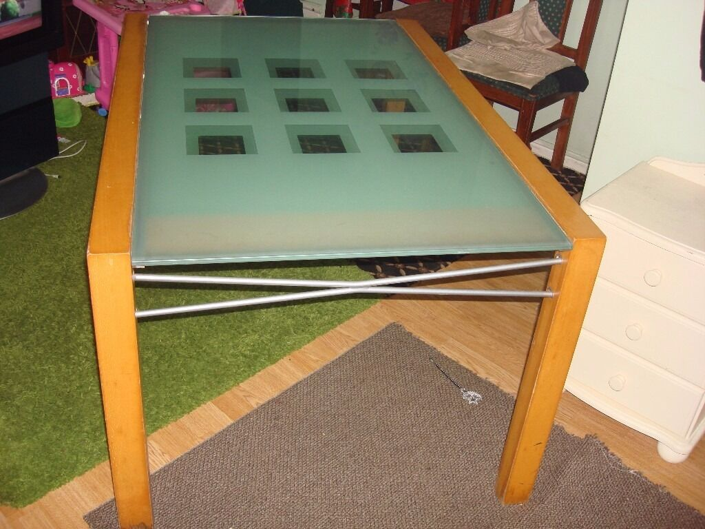 for sale extendable dining table glass and wood frame good conditionin Bradford, West YorkshireGumtree - for sale extendable dining table glass and wood frame this table is on good condition size length 1,40cm x1,40 cm 2,80 cm height 74cm ,width 95cm for more info and view please call thanks