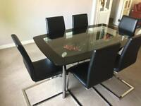 Glass table and 6 chairs for sale