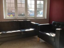 IKEA black leather sofa and chair