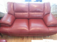 sofa two and three seater in red leather