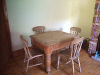 Pine wood table with 4 chairs.