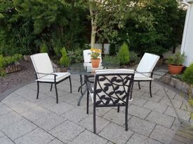 Pretty cast iron 4 seat patio set