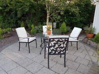 Pretty cast iron 4 seat patio set