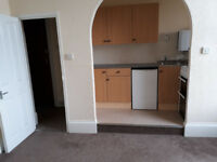1 bedroom flat to rent. Off road car park. Water and heating included. Town centre.