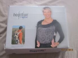 Hoppediz ergonomic baby carrying sling/wrap, as new