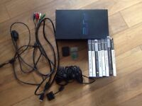 Original Fat PS2 with official controller, cables and 8 games