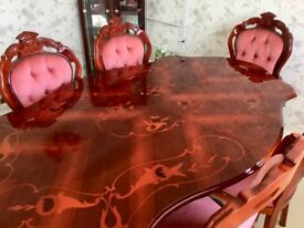 Polished inlaid table and 6 chairs excellent condition