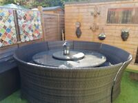 Large round garden table and chairs.