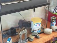 Fish tank with some accessories, sma tin placed in side for size reference