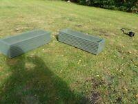 two garden planter troughs