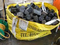 The builders bag full of granite cobbles