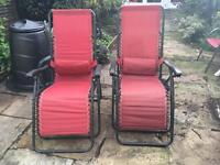 2 red reclining garden chairs