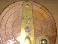 A lovely vintage milwards wooden brass back reel