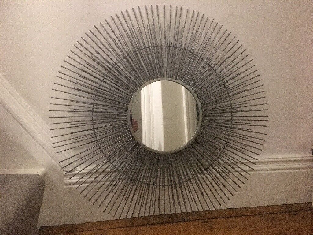 Silver metal mirror with metal spikes