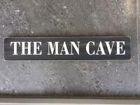 The man cave wooden sign