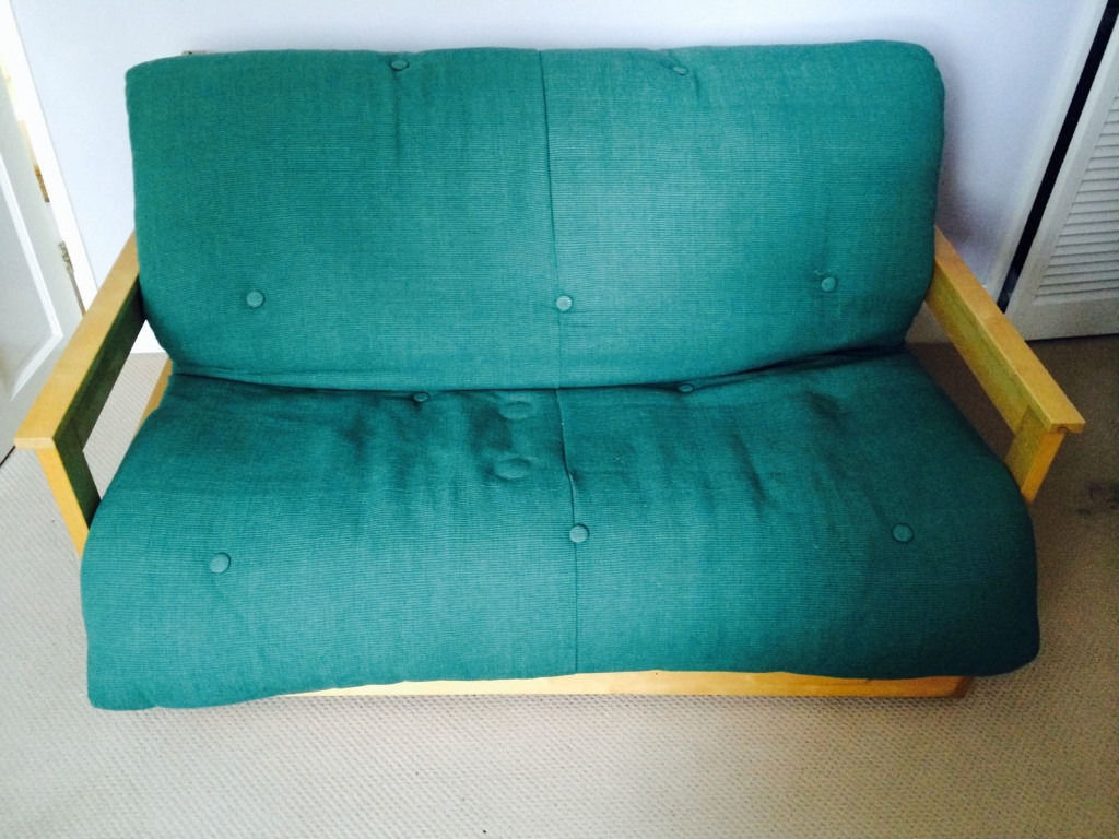 Futon Company two seater futon sofa bed with pull out storage trayin Ealing, LondonGumtree - Futon Company two seater futon sofa bed 147 cm wide Green and in good condition with solid wood frame with armrests, clean Easy to use fold out mechanism and comfortable to sit and sleep on Can fit as it is in most cars ) no dismantling as it just...