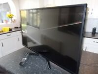 """42"""" FULL HD LED POLAROID TV in perfect working order comes complete with remote and stand"""