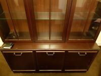 brown mint condition book shelf with three door storage with lights fitted inside.