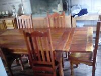 Large solid wood table with 6 chairs