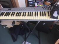 Oxygen 61 midi keyboard with pedal and stand