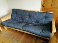 Futon style sofa bed- almost 'as new' condition.