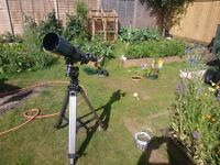 Telescope for sale with tripod, lenses and books on astronomy